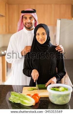 Arabian couple in kitchen cooking food