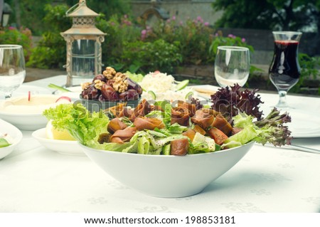 Arabian food of fattoush, dates, jalab served in Ramadan - stock photo