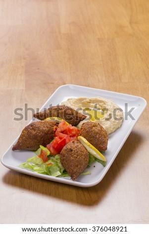 arabian Food of Fried Kibe on a plate - stock photo