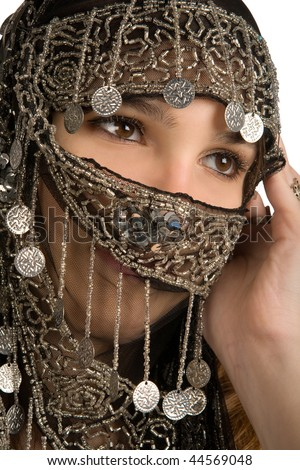 Arabian/indian woman with her face covered - stock photo