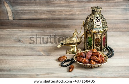 Arabian lantern, dates and rosary. Islamic holidays concept. Ramadan decoration - stock photo