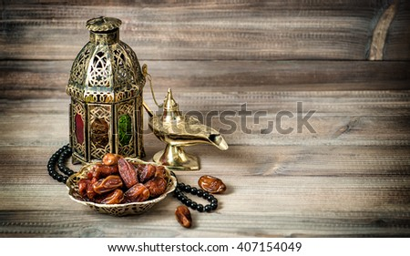 Arabian lantern, golden lamp and fruits. Islamic holidays decoration. Vintage style toned photo - stock photo