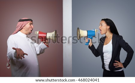 Arabian man and western woman shouting in megaphones at each other. Cultural misunderstanding, interracial marriage concept