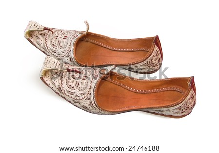Arabian oriental shoes in the Aladdin style isolated on white background - stock photo