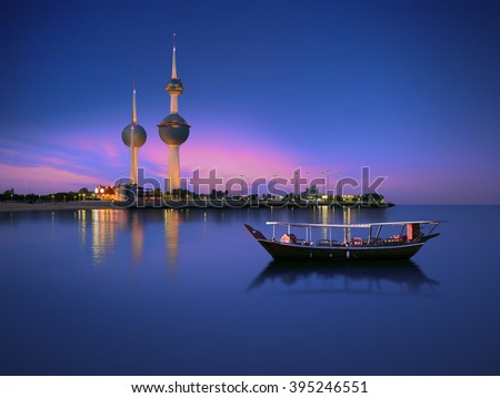 Arabian passenger boat during blue hour next to kuwait tower  - stock photo