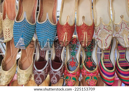Arabian Slippers - Intricate beadwork adorn these arabian slippers seen at a market in Dubai. - stock photo