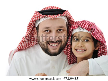 Arabian son and his father wearing keffiyeh - stock photo