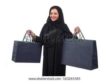 Arabian woman carrying shopping bags isolated on white - stock photo