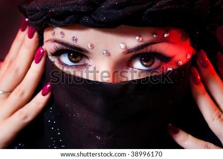 arabian woman close-ups brown eye look. - stock photo