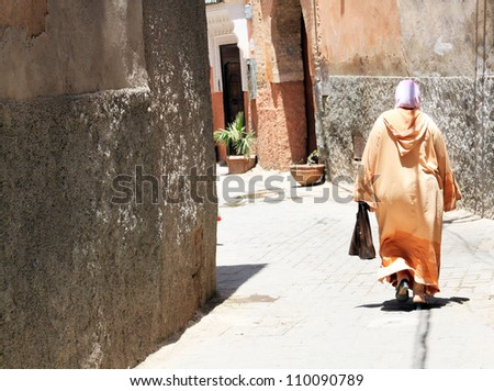 Arabian woman in the street of Marrakesh, Morocco - stock photo
