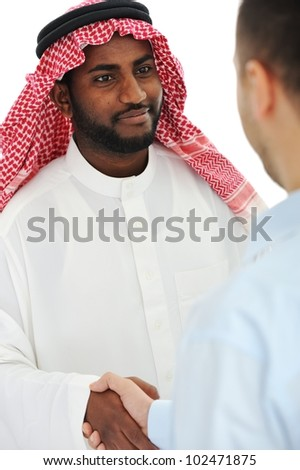 Arabic and european american business man making a deal and handshaking - stock photo