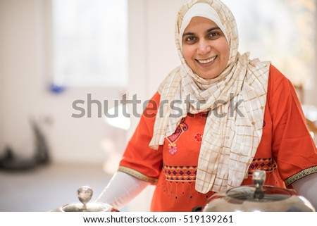 Arabic beautiful housewife making a lunch in kitchen