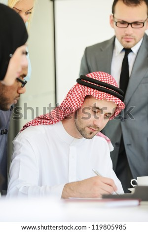 Arabic business man signing a contract - stock photo