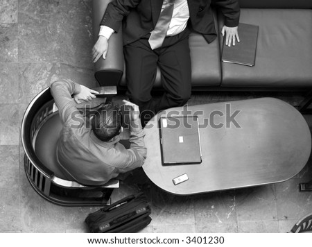Arabic business men having a meeting in a hotel lounge. - stock photo