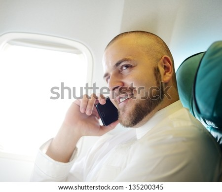 Arabic businessman in the Middle east speaking on cell phone - stock photo