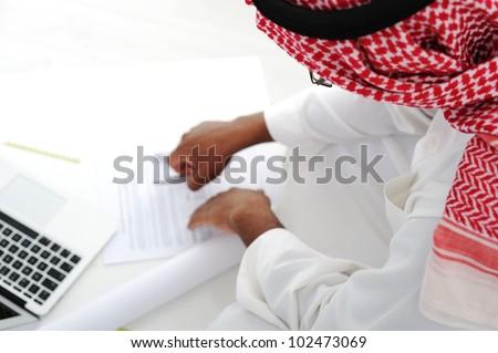 Arabic businessman working - stock photo