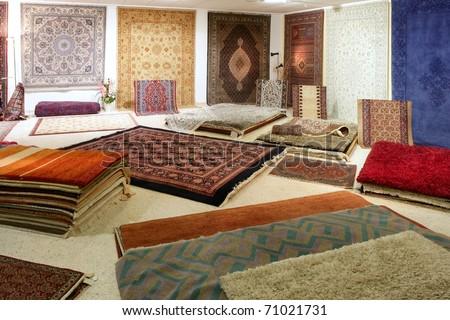 Arabic carpet shop exhibition colorful carpets exposition room - stock photo
