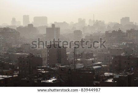 Arabic city with tall buildings. Cairo city center. - stock photo