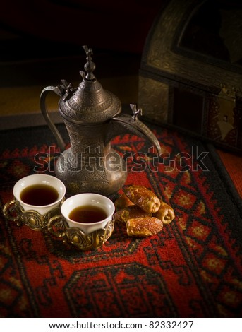 Arabic coffee and dates set up. - stock photo