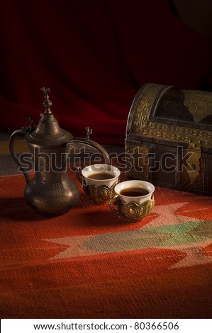 Arabic coffee cups in traditional setting. - stock photo
