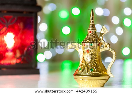 Arabic Coffee pot and lantern with colorful out of focus light as background. Ramadan, Eid concept - stock photo