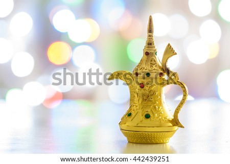 Arabic Coffee pot colorful out of focus light as background. Ramadan, Eid concept. - stock photo