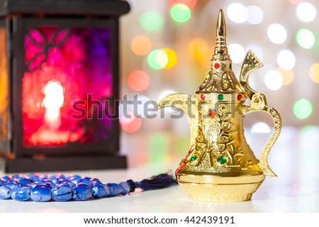 Arabic Coffee pot,Muslim prayer beads and lantern with colorful out of focus light as background. Ramadan, Eid concept - stock photo