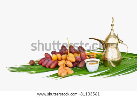 Arabic coffee pot with date fruits - stock photo