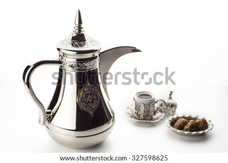 Arabic coffee pot with fresh dates - stock photo