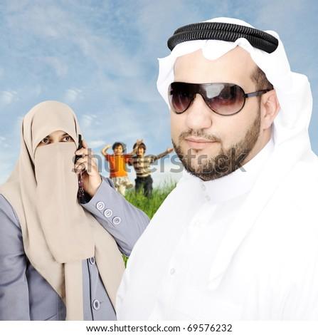 Arabic Couple muslim Looking at camera - stock photo