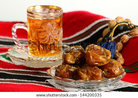 Arabic dates and tea. Ramadan tradition. - stock photo