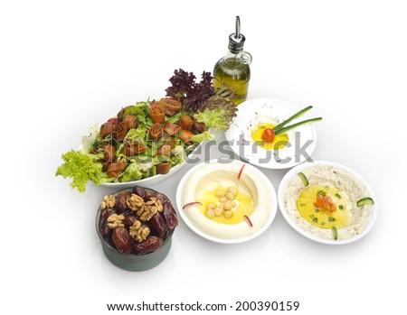 Arabic food of Hommos, Labneh,Fattoush, & Dates served during Ramdan - stock photo