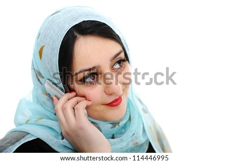 Arabic girl talking on cell phone - stock photo