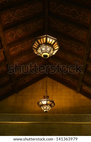 Arabic hanging lamps in an islamic interior - stock photo
