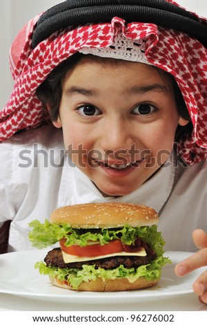 Arabic kid with burger