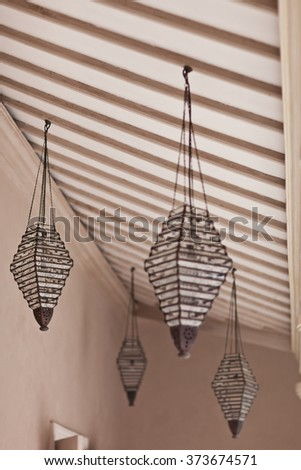 Arabic Lamp. Marokkan Style Interior. Glass Lamp and Wood Ceiling. Inside Room Decor. - stock photo