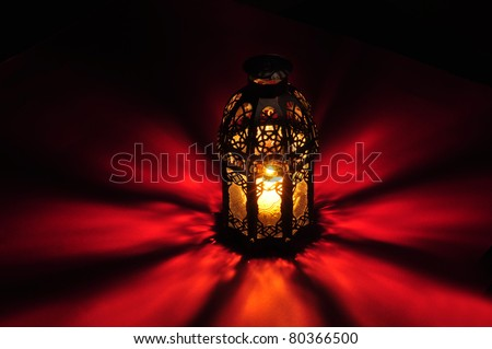 Arabic lamp with beautiful lights in the background - stock photo
