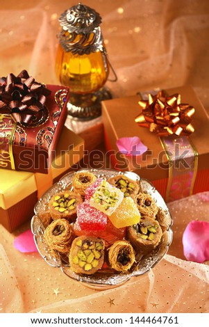 Arabic lantern, sweet and gifts - stock photo