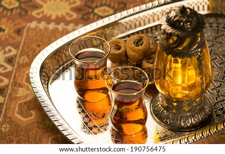Arabic lantern, sweet and tea still life - stock photo