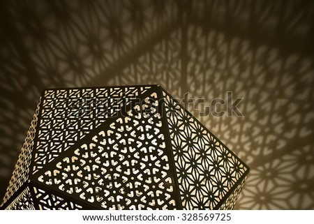Arabic Lights with shadows against wall - stock photo
