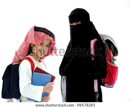 Arabic little boy and girl going to school - stock photo