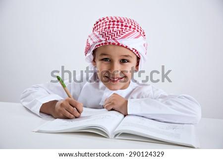 Arabic Little Boy Doing Homework - stock photo