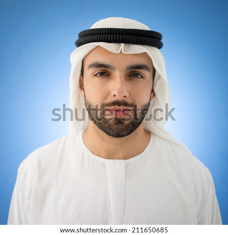 Arabic man on blue background - stock photo