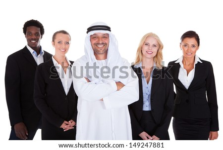 Arabic Man Standing With Businesspeople Over White Background - stock photo