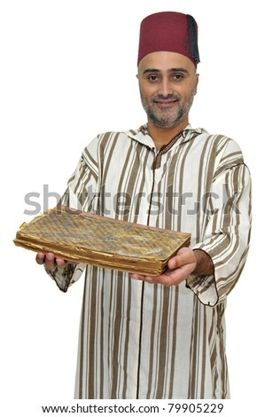 Arabic man with very old book isolated in white - stock photo