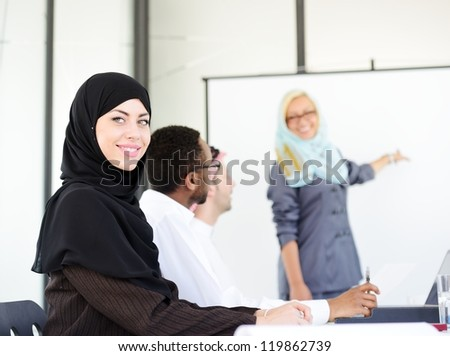 Arabic middle eastern woman having a business presentation with copy space board - stock photo