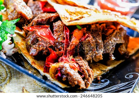 Arabic mixed barbeque plate with sauces - stock photo