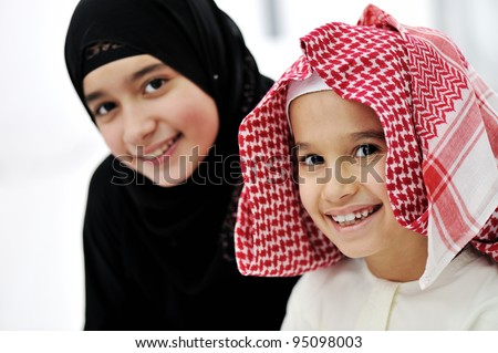 Arabic Muslim brother and sister - stock photo