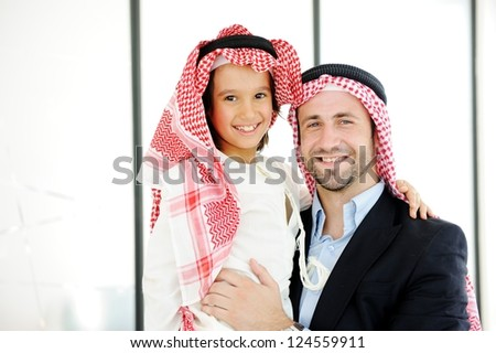 Arabic Muslim business people with children at office - stock photo