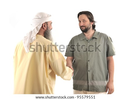 Arabic Muslim businessman shaking hands - stock photo